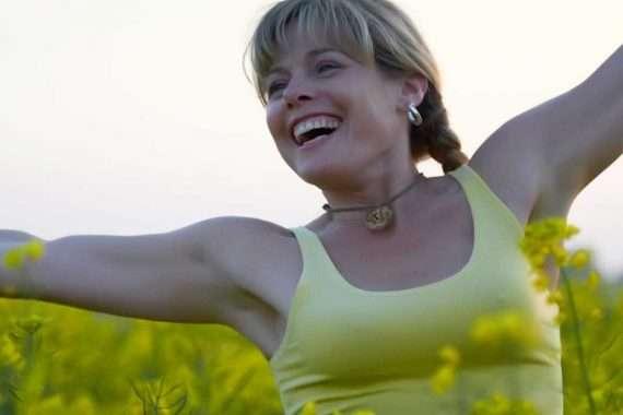 Ceri Lee, happy in a field of flowers